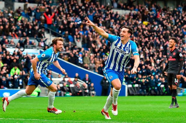 Lewis Dunk (C) celebrates after scoring Brighton's opening goal. Photo: AFP/Getty Images