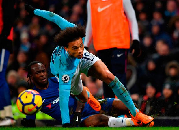 Leroy Sane (R) makes it through a tackle from Chelsea's Victor Moses. Photo: AFP/Getty Images