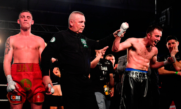 IRON MAN: Craig O'Brien celebrates winning the Irish light middleweight title. Photo by Ramsey Cardy/Sportsfile