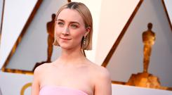 Saoirse Ronan arrives at the Oscars on Sunday, March 4, 2018, at the Dolby Theatre in Los Angeles. (Photo by Jordan Strauss/Invision/AP)