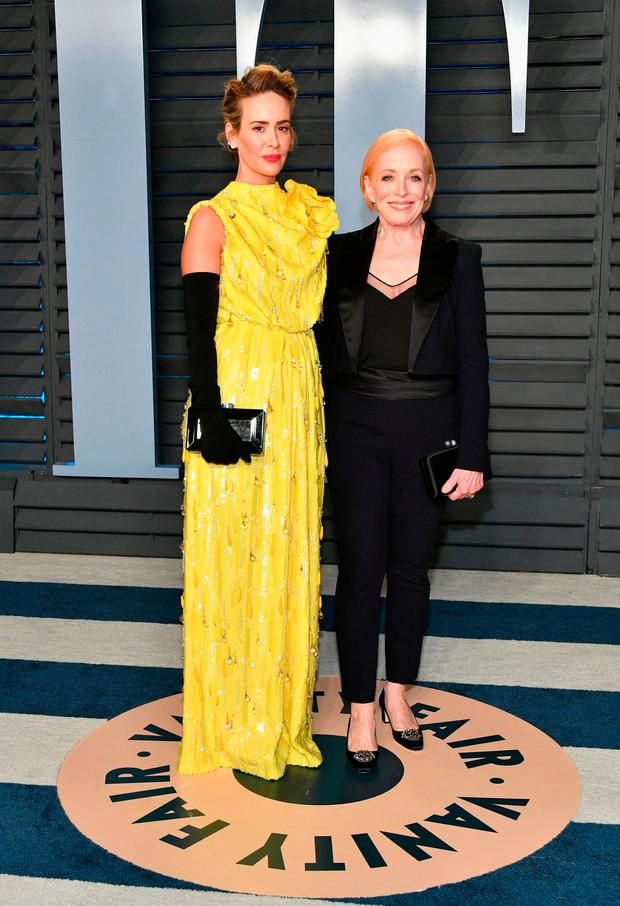 Sarah Paulson (L) and Holland Taylor attend the 2018 Vanity Fair Oscar Party hosted by Radhika Jones at Wallis Annenberg Center for the Performing Arts on March 4, 2018 in Beverly Hills, California. (Photo by Dia Dipasupil/Getty Images)