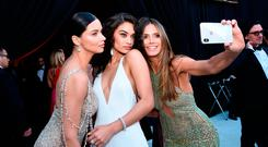 (L-R) Adriana Lima, Shanina Shaik, Heidi Klum attends the 26th annual Elton John AIDS Foundation Academy Awards Viewing Party sponsored by Bulgari, celebrating EJAF and the 90th Academy Awards at The City of West Hollywood Park on March 4, 2018 in West Hollywood, California. (Photo by Dimitrios Kambouris/Getty Images for EJAF)