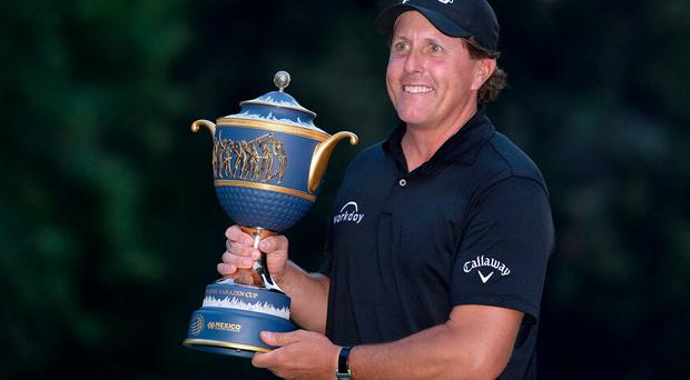 Phil Mickelson poses with the winner's trophy following the final round of the WGC - Mexico Championship golf tournament at Club de Golf Chapultepec. Credit: Orlando Ramirez-USA TODAY Sports