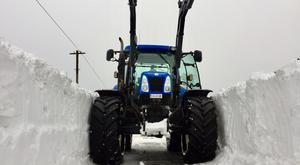 Farmers in Laois clearing roads that were impassable with snow.