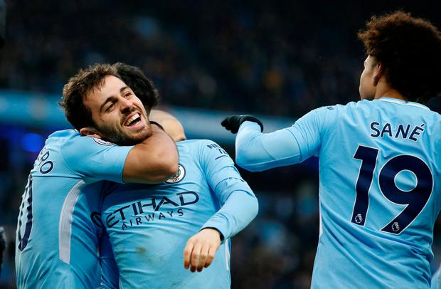 Soccer Football - Premier League - Manchester City vs Chelsea - Etihad Stadium, Manchester, Britain - March 4, 2018 Manchester City's Bernardo Silva celebrates scoring their first goal with team mates. REUTERS/Andrew Yates