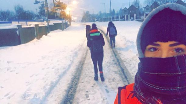 Aoife Butler walking to work with her three colleagues during Storm Emma