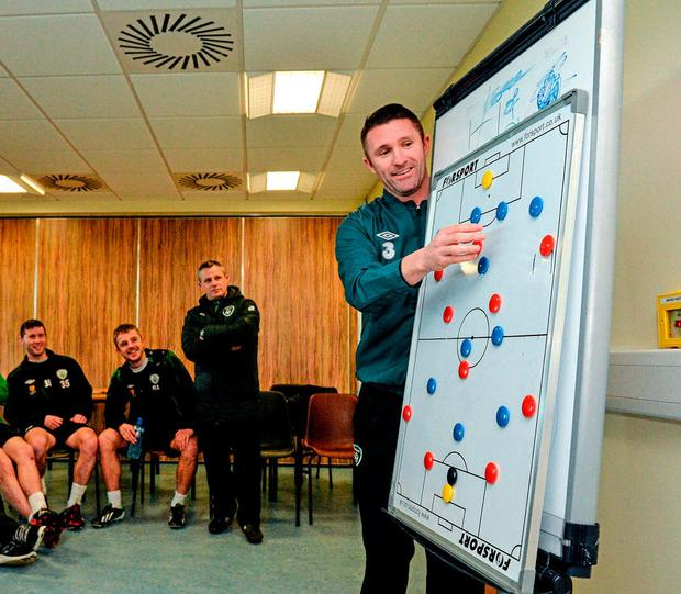 Robbie Keane discusses tactics with IT Carlow students during an a UEFA A Coaching Licence Course in 2014. Photo: Sportsfile