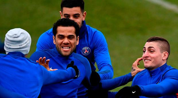 Dani Alves in the thick of things at PSG training alongside team-mate Marco Verratti (right). Photo: Franck Fife/AFP/Getty Images