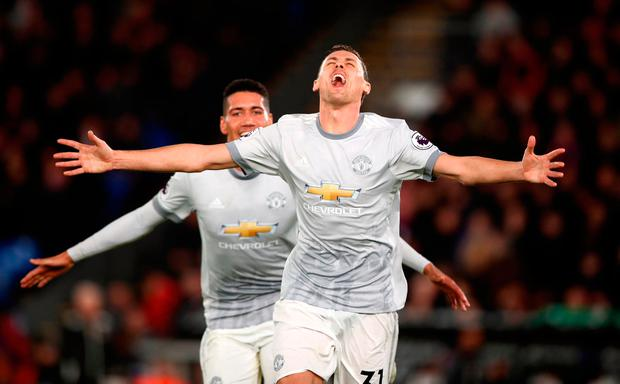 Manchester United's Nemanja Matic celebrates scoring his side's third goal of the game during the Premier League match at Selhurst Park, London. John Walton/PA Wire.