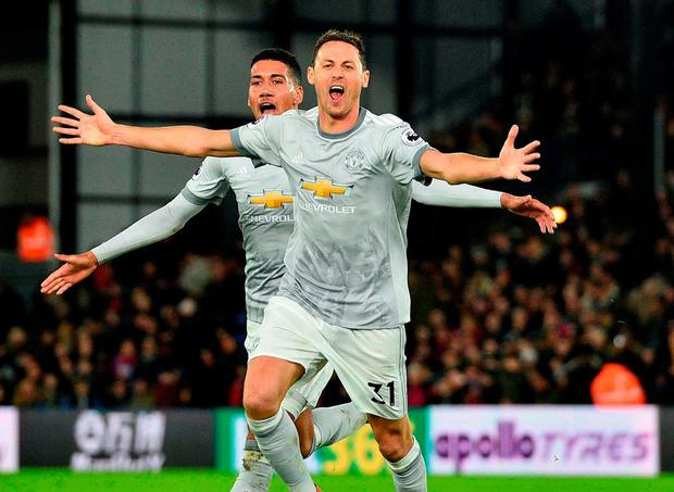 Nemanja Matic (R) celebrates scoring his team's third goal. Photo: Glyn Kirk/AFP/Getty Images
