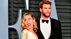 Miley Cyrus (L) and Liam Hemsworth attend the 2018 Vanity Fair Oscar Party hosted by Radhika Jones at Wallis Annenberg Center for the Performing Arts on March 4, 2018 in Beverly Hills, California. (Photo by Dia Dipasupil/Getty Images)