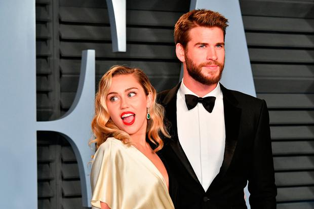 Miley Cyrus and Liam Hemsworth attend the 2018 Vanity Fair Oscar Party hosted by Radhika Jones at Wallis Annenberg Center for the Performing Arts