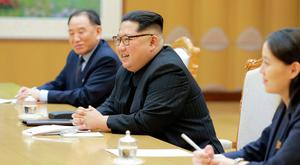 North Korean leader Kim Jong Un meets members of the special delegation of South Korea's President in this photo released by North Korea's Korean Central News Agency (KCNA) on March 6, 2018. KCNA/via Reuters