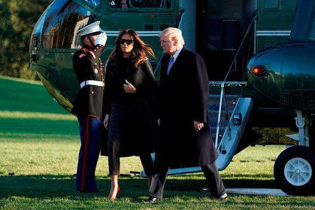 U.S. President Donald Trump walks with first lady Melania Trump on South Lawn of the White House upon their return to Washington, U.S., from Palm Beach, Florida, March 3, 2018. REUTERS/Yuri Gripas