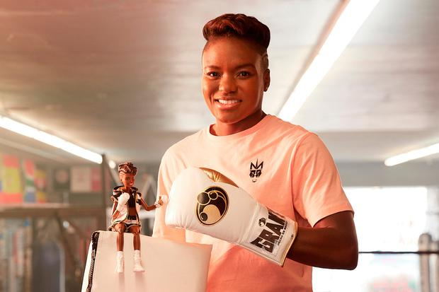Olympic boxing champion Nicola Adams with a one-off first ever boxer Barbie Credit: Mattel/PA Wire