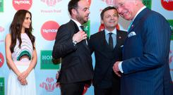 The Prince of Wales meeting celebrity ambassador Cheryl and hosts Anthony 'Ant' McPartlin and Declan 'Dec' Donnelly at the Prince's Trust Awards at the London Palladium Credit: Geoff Pugh/The Daily Telegraph/PA Wire