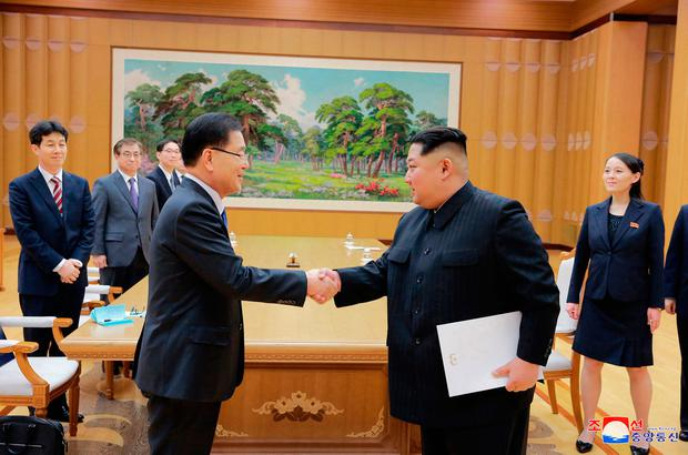 North Korean leader Kim Jong Un, front right, shakes hands with South Korean National Security Director Chung Eui-yong (Korean Central News Agency/Korea News Service via AP)