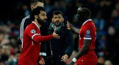 Liverpool's Mohamed Salah comes on as a substitute to replace Sadio Mane