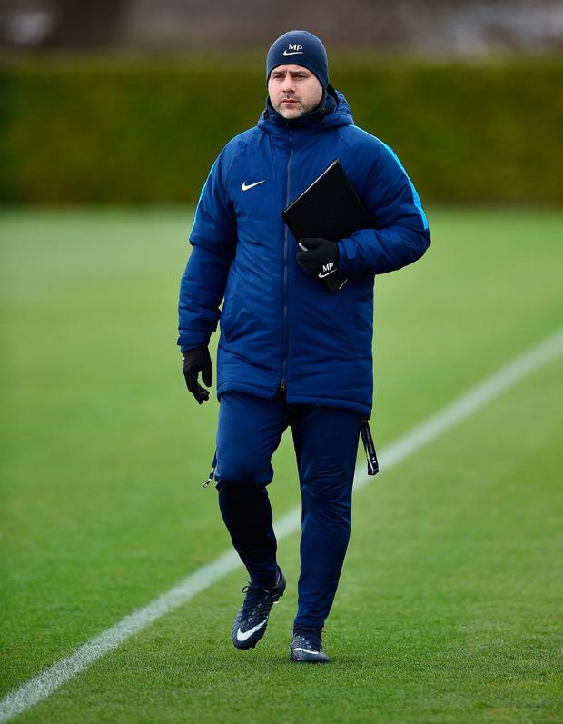 Mauricio Pochettino looks on during Tottenham's training session yesterday. Photo: Glyn Kirk/AFP
