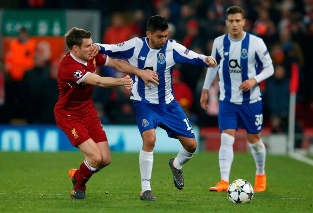 Liverpool's James Milner in action with Porto's Jesus Corona. Photo: Andrew Yates/Reuters