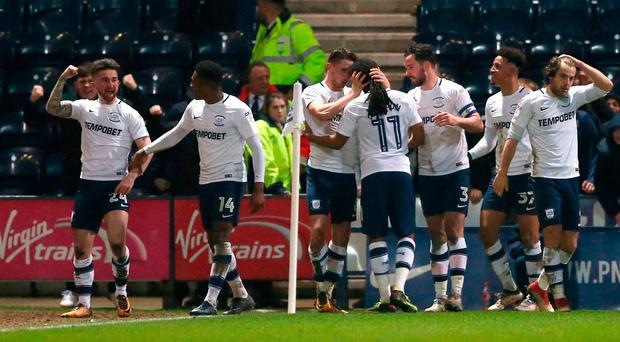Preston North End's Sean Maguire (left) celebrates scoring his side's second goal of the game during the Sky Bet Championship match at Deepdale