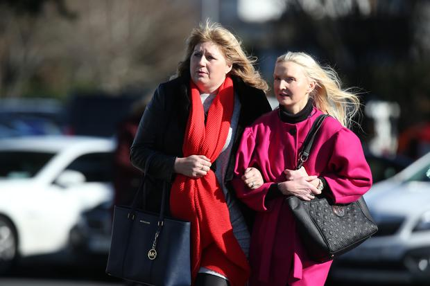 Author Claudia Carroll arrives with a friend at Our Lady of Perpetual Succour Church, Foxrock for the funeral of best-selling author Emma Hannigan. Photo: Steve Humphreys