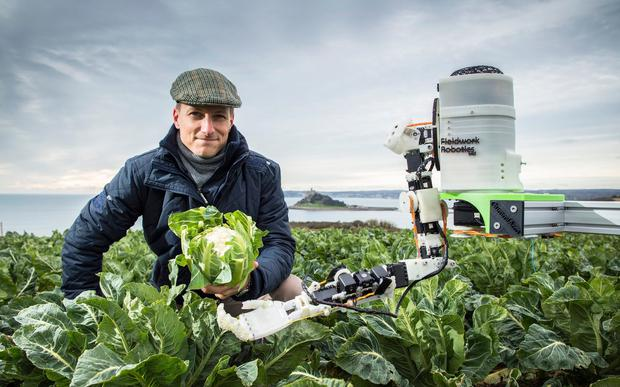 Dr Martin Stoelen and his 'GummiArm' robot. Credit: University of Plymouth