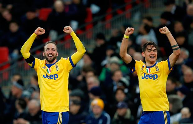 Soccer Football - Champions League Round of 16 Second Leg - Tottenham Hotspur vs Juventus - Wembley Stadium, London, Britain - March 7, 2018 Juventus' Paulo Dybala celebrates scoring their second goal with Gonzalo Higuain REUTERS/Eddie Keogh