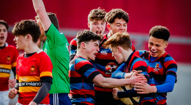 Alex Wood celebrates his try with his St Munchin's team-mates