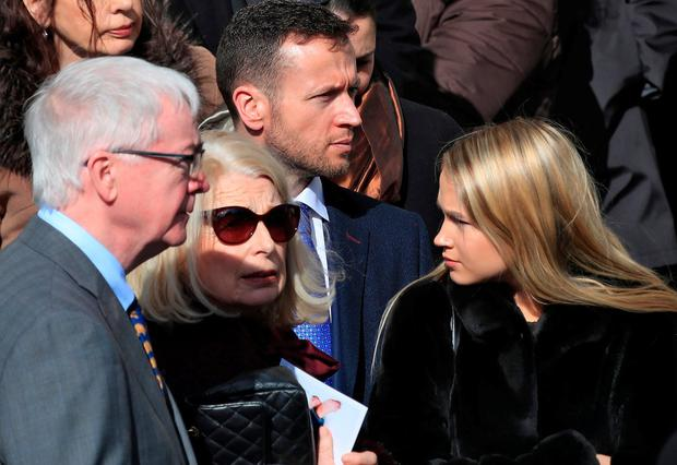 Emma Hannigan's parents Philip and Denise, husband Cian and daughter Kim at the funeral at Our Lady of Perpetual Succour in Foxrock, Co Dublin. Photo: Collins