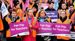Hundreds of teachers kept up the pressure in a protest outside the Dáil yesterday. Photo: Steve Humphreys