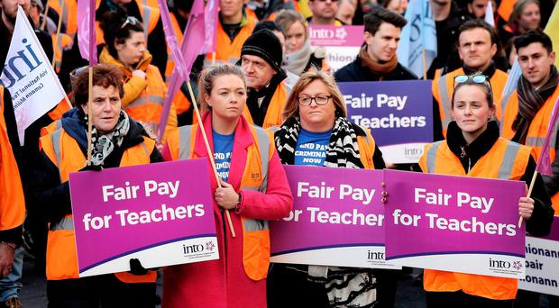 Teachers 'not going away' in pay equality fight