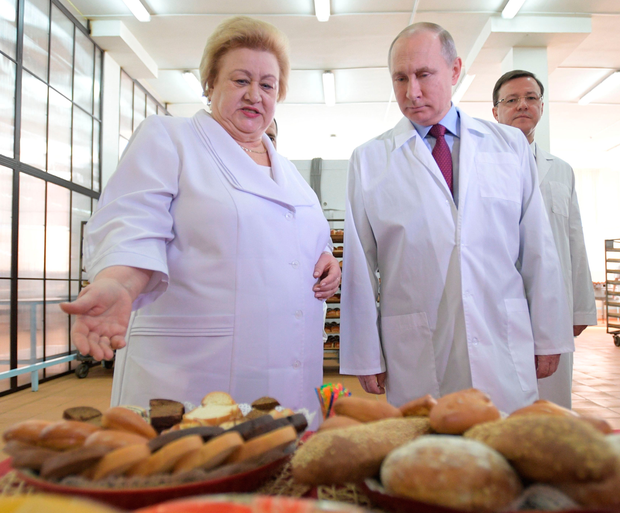 Russian President Vladimir Putin visits the Samara bakery and confectionery complex in Samara yesterday. Photo: Getty Images