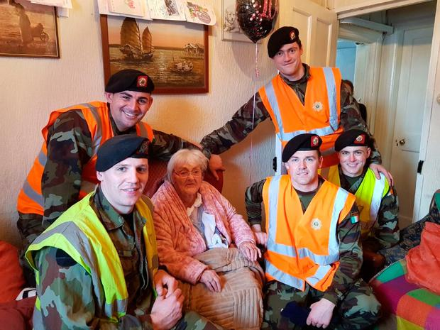 Roundwood woman Maura Doyle, who was dug out by troops from the 7th Infantry bn Lt Richard O'Hagan, Cpl Wayne Casey, Pte Mick McCabe, Pte Gareth Callaghan, and Pte Paul Keane, who called back with a cake and card to celebrate her 100th birthday the next day.