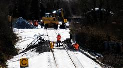 Irish Rail contractors repair the track at Inch, Co Wexford, which has closed due to subsidence. Photo: Garry O'Neill