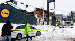 GardaI at the scene of the collapsed Lidl store in Fortunestown Lane last week