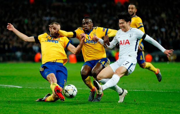 Tottenham's Son Heung-min in action with Juventus's Blaise Matuidi and Giorgio Chiellini Photo: Reuters/John Sibley