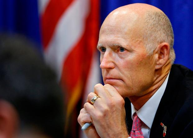 Florida Governor Rick Scott listens during a meeting with law enforcement, mental health, and education officials about how to prevent future tragedies in the wake of last week's mass shooting at Marjory Stoneman Douglas High School, at the Capitol in Tallahassee, Florida, U.S., February 20, 2018. REUTERS/Colin Hackley/File Photo
