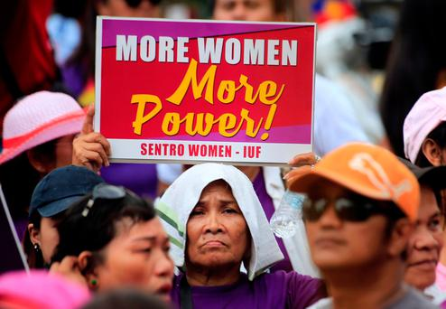 A women rights activist displays a placard during a celebration of the Women's International Day in Quiapo city, metro Manila, Philippines March 8, 2018. REUTERS/Romeo Ranoco