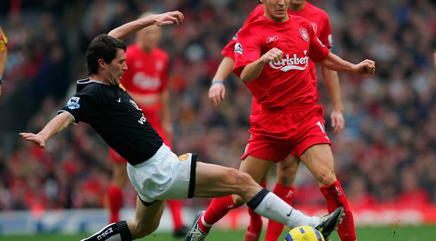 Roy Keane of Manchester United tackles Luis Garcia of Liverpool