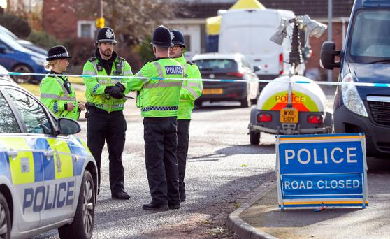 Police activity in a cul-de-sac in Salisbury near to the home of former Russian double agent Sergei Skripal as a nerve agent is believed to have been used to critically injure him and his daughter Yulia. Photo: Andrew Matthews/PA Wire