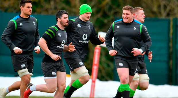 Tadhg Furlong, right, with team-mates during Ireland training