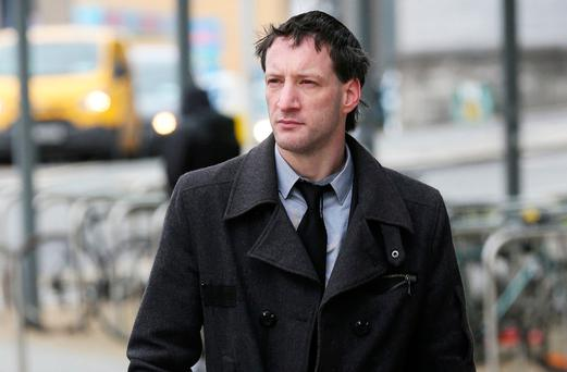 John Tighe denies murdering his six-month-old baby son. Photo: Collins Courts