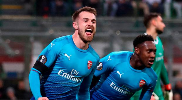 Danny Welbeck rushes to join in as Aaron Ramsey celebrates after scoring Arsenal's second goal at the San Siro. Photo: Catherine Ivill/Getty Images