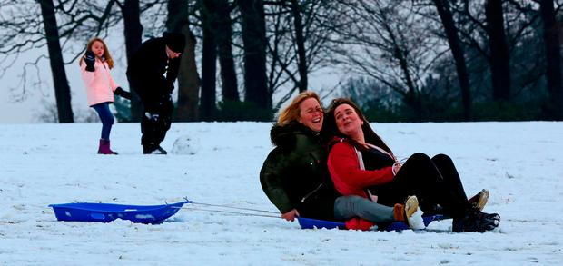People sledding in Woolton in Liverpool as weather warnings of snow and ice are in effect for many parts of Britain. Photo: PA