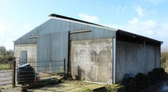 There is a wide range of farm buildings including a two-bay, back-to-back slatted shed with cubicles at one side.