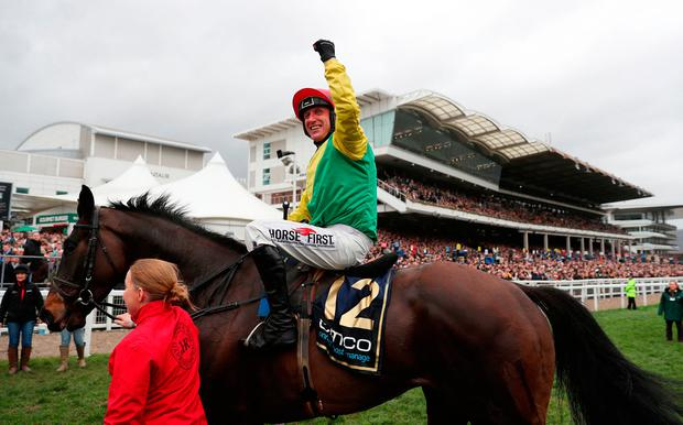 Robbie Power celebrates with Sizing John after winning the Gold Cup. Photo: David Davies/PA
