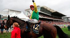 Robbie Power celebrates with Sizing John after winning the Gold Cup in 2017. Photo: David Davies/PA