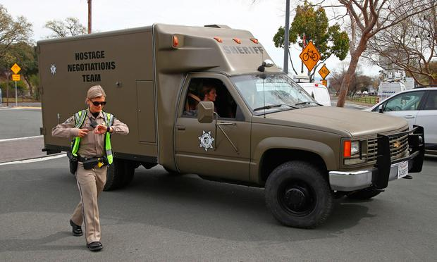 A sheriff's hostage negotiation team passes a California highway patrol checkpoint at the Veterans Home of California in Yountville, Calif. (AP Photo/Ben Margot)