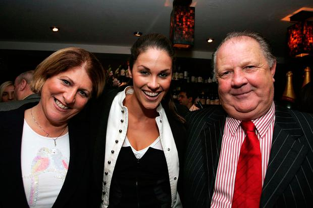 Glenda Gilson, with her parents Noel and Aileen Gilson, who have been advised to sell their house. Photo: Tom Burke